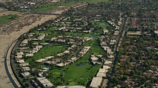 AX0013_043 - 5K stock footage aerial video of a residential neighborhood, South Palm Springs, California