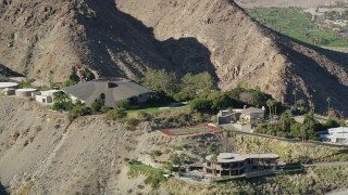 AX0013_045 - 5K stock footage aerial video of a mansion in the hills, West Palm Springs, California