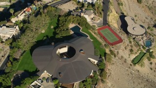 AX0013_046 - 5K stock footage aerial video of a bird's eye of a mansion in the hills, West Palm Springs, California