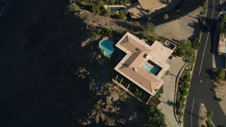 AX0013_047 - 5K stock footage aerial video of a bird's eye view of a mansion in the hills, West Palm Springs, California