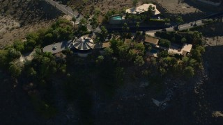 AX0013_048 - 5K stock footage aerial video fly away from mansions on the hill, West Palm Springs, California