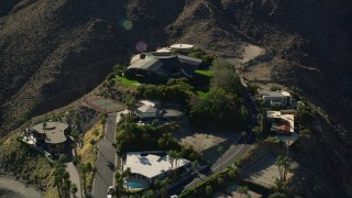 AX0013_049E - 5K stock footage aerial video fly over mansions on the hill top, West Palm Springs, California