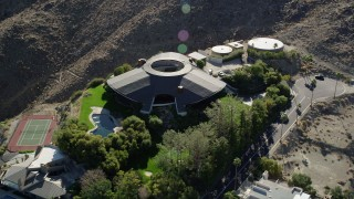 AX0013_050 - 5K stock footage aerial video of a mansion on a hill, West Palm Springs, California