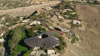 AX0013_051E - 5K stock footage aerial video of orbiting a hilltop mansion, West Palm Springs, California