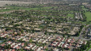AX0013_053 - 5K aerial stock footage video of residential neighborhoods and golf course, West Palm Springs, California