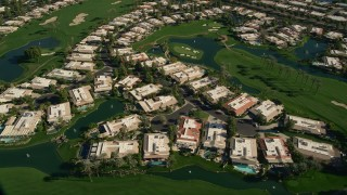 AX0013_063 - 5K stock footage aerial video of upscale homes on a golf course, Rancho Mirage, California