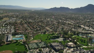 AX0013_071 - 5K stock footage aerial video approach residential neighborhoods, Palm Desert, California
