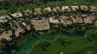 AX0013_076 - 5K aerial stock footage video of upscale home along a golf course, Indian Wells, California
