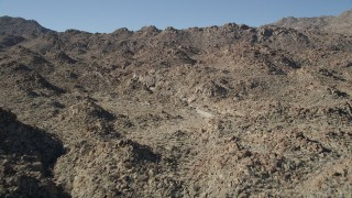 AX0014_004 - 5K stock footage aerial video of flying over rocky ridges, San Jacinto Mountains, California