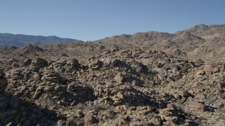 AX0014_005 - 5K stock footage aerial video fly over a rocky summit, San Jacinto Mountains, California
