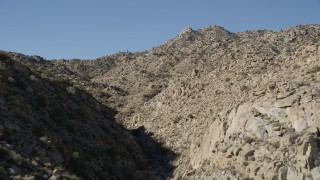 AX0014_007 - 5K stock footage aerial video fly through a rocky canyon, San Jacinto Mountains, California