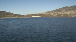 AX0014_027 - 5K stock footage aerial video fly low over Lake Hemet and approach Hemet Dam, California