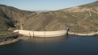 AX0014_028 - 5K stock footage aerial video fly low over Lake Hemet and approach Hemet Dam, California