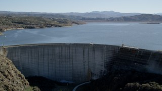 AX0014_030 - 5K stock footage aerial video fly over Hemet Dam revealing Lake Hemet; California