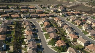 AX0014_036 - 5K stock footage aerial video approach residential neighborhood and tract homes, Temecula, California