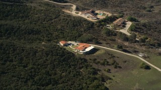AX0014_037 - 5K stock footage aerial video of a home surrounded by trees, Temecula, California