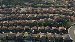 AX0014_038 - 5K stock footage aerial video fly by residential neighborhood, Temecula, California