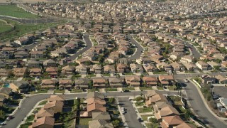 AX0014_039E - 5K stock footage aerial video fly low over tract homes in residential neighborhoods, Temecula, California