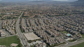 AX0014_044 - 5K stock footage aerial video approach residential neighborhoods and tilt to homes, Temecula, California