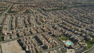 AX0014_044E - 5K stock footage aerial video approach residential neighborhoods and tilt to homes, Temecula, California