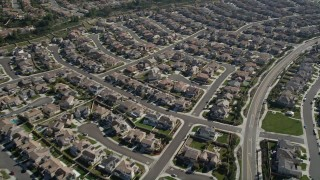 AX0014_045 - 5K stock footage aerial video fly over residential neighborhoods revealing a sports park, Temecula, California