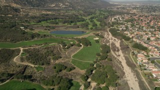 AX0014_050 - 5K stock footage aerial video of flying over a golf course, Temecula, California