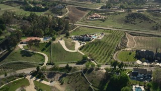 AX0014_055 - 5K stock footage aerial video of vineyards and a mansion, Temecula, California
