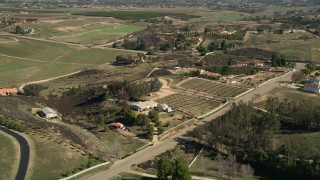 AX0014_057 - 5K stock footage aerial video fly over rural homes, Temecula, California