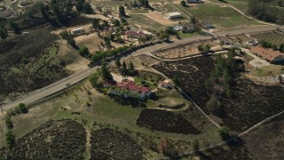 AX0014_065 - 5K stock footage aerial video of orbiting a mansion, Temecula, California