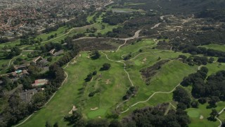 AX0015_002 - 5K aerial stock footage video fly by greens at a golf course, Temecula, California