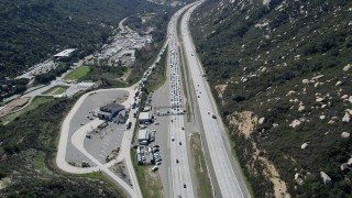 AX0015_004 - 5K stock footage aerial video approach highway inspection facility beside the freeway, Temecula, California