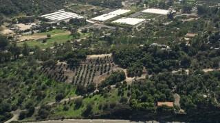 AX0015_008 - 5K stock footage aerial video of a hillside rural home, Fallbrook, California