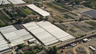 AX0015_010 - 5K stock footage aerial video of farmland and greenhouses, Fallbrook, California