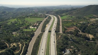 AX0015_011 - 5K stock footage aerial video of following interstate with light traffic through the country, Fallbrook, California
