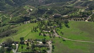 AX0015_012 - 5K stock footage aerial video of hilltop homes among farmland, Fallbrook, California