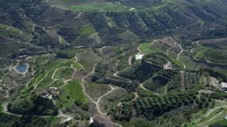 AX0015_013 - 5K stock footage aerial video of farmland on hills, Fallbrook, California