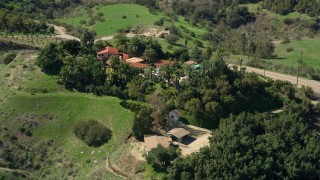 AX0015_016 - 5K stock footage aerial video fly by large hilltop house, Fallbrook, California