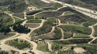 AX0015_017 - 5K stock footage aerial video fly by farmland on hills, Fallbrook, California