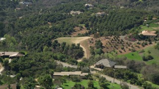 AX0015_020 - 5K stock footage aerial video of rural homes among trees, Fallbrook, California
