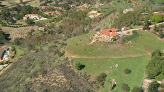 AX0015_023 - 5K stock footage aerial video of orbiting a house on a hilltop, Fallbrook, California