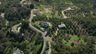 AX0015_024 - 5K aerial stock footage video of homes on hills, Fallbrook, California