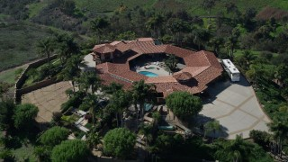 AX0015_029 - 5K stock footage aerial video of flying over a large country house, Fallbrook, California