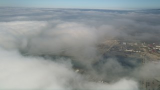 AX0016_016 - 5K stock footage aerial video flyby clouds to reveal Camp Pendleton, California