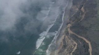 AX0016_033 - 5K stock footage aerial video of a bird's eye of ocean waves rolling toward a beach and cliffs, Oceanside, California