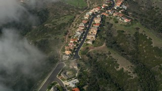 AX0016_040 - 5K stock footage aerial video bird's eye of upscale hillside homes, San Clemente, California
