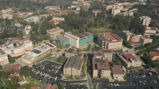 AX0016_078 - 5K stock footage aerial video approach and fly by the Irvine School of Medicine in Irvine, California