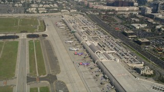 AX0016_083 - 5K stock footage aerial video of passenger jets at terminals, John Wayne Airport, Orange County, California