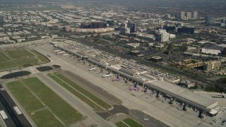 AX0016_084 - 5K stock footage aerial video of passenger jets and terminals at John Wayne Airport, Orange County, California
