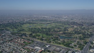 AX0016_092 - 5K stock footage aerial video of approaching Mile Square Regional Park and golf course, Fountain Valley, California