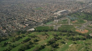 AX0016_094 - 5K stock footage aerial video fly over Mile Square Golf Course, to and approach residential neighborhoods, Fountain Valley, California